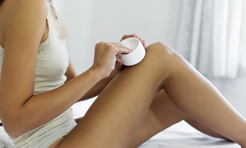 Apply-Lotion-to-Legs